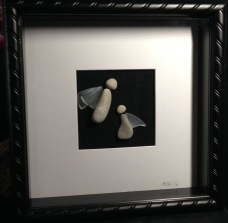 "Stone Angels with glass wings. Framed in 10""x10"" shadow box frame"