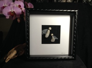 "Stone Angels with glass wings framed in 10""x10"" shadow box frame"