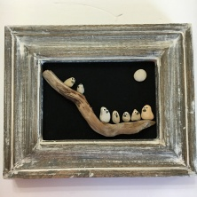 Birds on driftwood in solid wood antique frame. no glass.