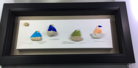 """ Regatta"". Features 4 sailboats with tumbled glass sails and stone boats."