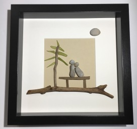 Couple on Bench. Features driftwood and glass tree.