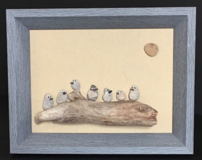 Birds on driftwood