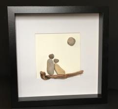 Couple on driftwood