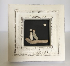Couple on driftwood, white wood frame