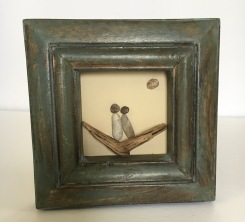 Couple on driftwood in rustic green frame