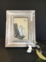 Couple on driftwood, white wood frame