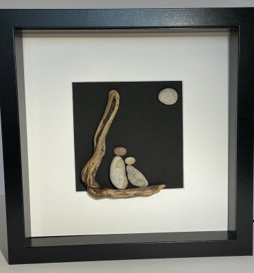 Couple on driftwood, with moon