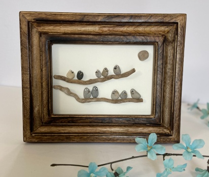 Birds on branches, brown wood frame